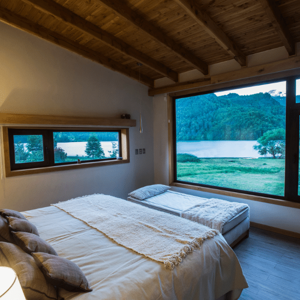 A bedroom at your accommodations on your Patagonia Yoga Retreat with The Travel Yogi.