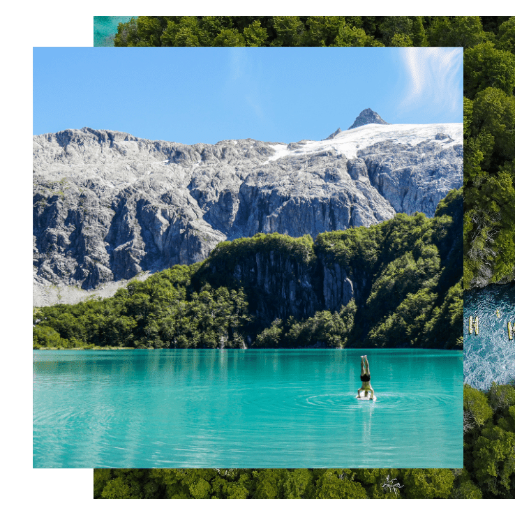 A person rafts on a teal green glacial lake amidst mountains on the Patagonia yoga retreat with The Travel Yogi.