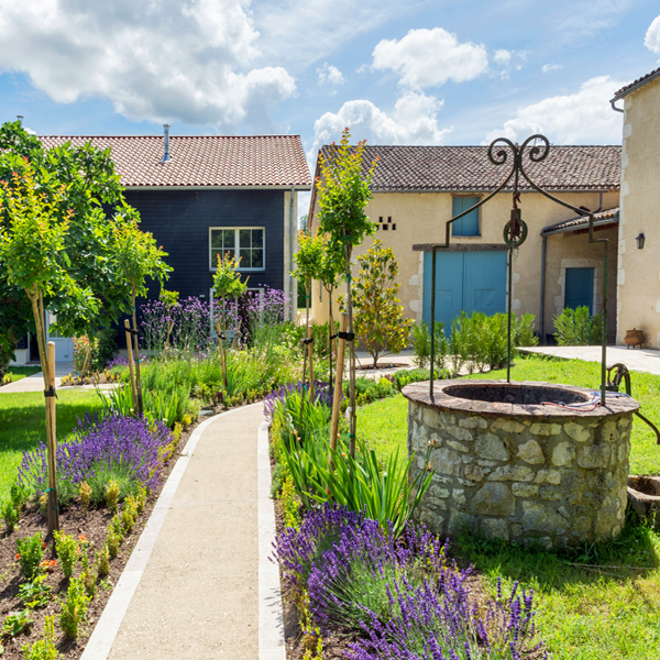 A stone pathway leads to quaint abodes on this yoga retreat in France with The Travel Yogi.