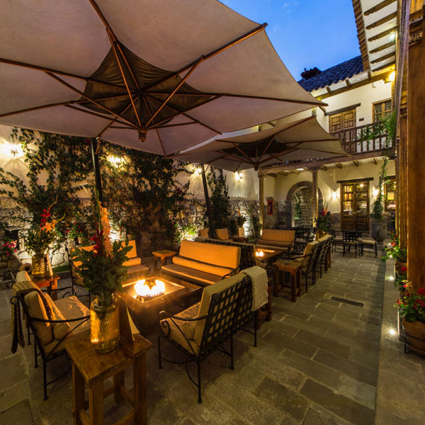 Outdoor dining by candlelight. Explore this Peru yoga retreat with The Travel Yogi light