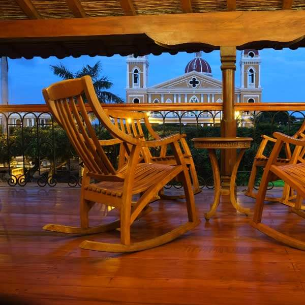 Rocking chairs at night overlooking Plaza Colon on this Nicaragua yoga surf retreat with The Travel Yogi.